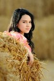 Beautiful girl enjoying the nature in the hay — Stock Photo
