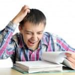Shocked businessman reading documents — Stock Photo #13767572