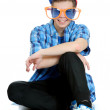 Teenage boy wearing huge orange and blue sunglasses, birthday party concept, isolated on white — Stock Photo #18625833