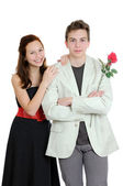 Valentines day. Attractive young couple with rose in hands isolated on the white background — Stock Photo
