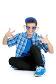 Teenage boy wearing huge orange and blue sunglasses, birthday party concept, isolated on white — Stock Photo