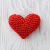 Red heart on white wooden background — Stock Photo