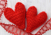 Red hearts on white wooden background — Stock Photo
