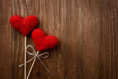 Red hearts on wooden background — Stock Photo