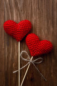 Red hearts on wooden background — Foto Stock