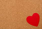 Red heart on pressured cork background — Стоковое фото