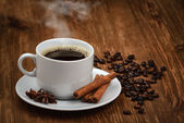Coffee cup on old wooden background — Stock Photo