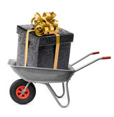 Big present box in wheelbarrow — Stock Photo