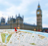 Travel destination London map push pin blur — Stock Photo