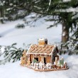 Gingerbread house in real snowy forest — Stock Photo