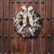 Christmas wreath on wooden door — Stock Photo