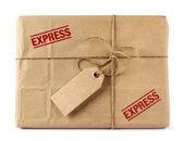 Brown mail delivery package with tag — Stock Photo