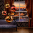 Stock Photo: Christmas balls hanging, winter street view window
