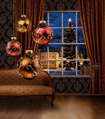 Christmas balls in room, town view window — Stock Photo