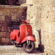 Red vintage scooter — Stock Photo