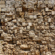 Old rough stone wall background — Stock Photo