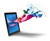 Tablet computer color splash — Stock Photo
