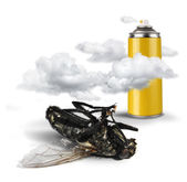 Insecticide spray bottle with dead fly — Stock Photo