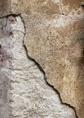 Grainy broken concrete wall background — Stockfoto