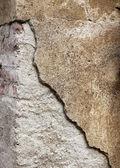 Kornig trasiga betongvägg bakgrund — Stockfoto