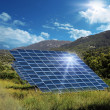 Solar energy panel collectors reflecting sun — Stock Photo