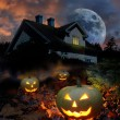 Haunted house halloween pumpkins — Stock Photo