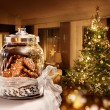 Gingerbread cookies jar Christmas tree room — Stock Photo