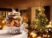 Gingerbread cookies jar Christmas tree room — Stock Photo