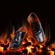 Business shoes dancing over fire — Stock Photo