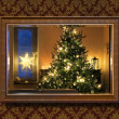 Christmas tree in wall mirror — Stock Photo