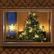 Christmas tree in wall mirror — Stock Photo #41047551