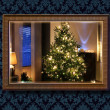 Christmas tree in wall mirror — Stock Photo #41047615