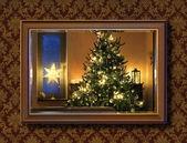 Christmas tree in wall mirror — Stock Photo