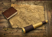 Old world map with telescope — Stock Photo