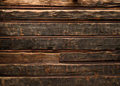 Old smutty log wall — Photo