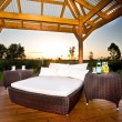 Stock Photo: Garden gazebo with romantic bed