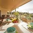 Dinner table on covered verandah — Stock Photo #25911363