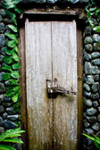 Old wooden door in a stone wall — Stock Photo