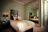 Bedroom interior reflected in mirrors — Stockfoto