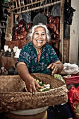 Happy Balinese woman in a temple — Stock Photo