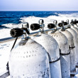 Air tanks and breathing apparatus on a boat — Stock Photo #29354265