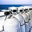 Stock Photo: Air tanks and breathing apparatus on boat