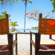 Two deck chairs overlooking a tropical beach — Stock Photo