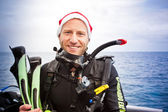 Smiling young man in scuba gear — Stock Photo