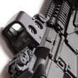 Modern tactical laser sght on assault carbine close-up. — Stock Photo