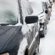 Snow covered cars — Stock Photo #27167239