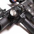 Stock Photo: Part of AR15 carbine with tactical flashlight
