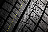 New winter car tire pattern. — Stock Photo