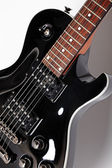 Black electric guitar — Stock Photo