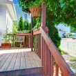 Small old deck with fence and white house. — Stock Photo #12737831